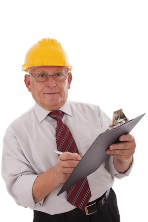 Experienced engineer looking to the clipboard (isolated on white) photo
