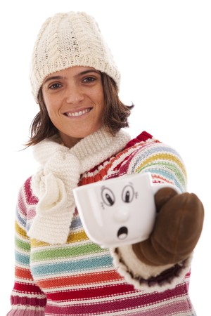 Happy woman showing her hot drink cup with a surprised face (isolated on white) photo