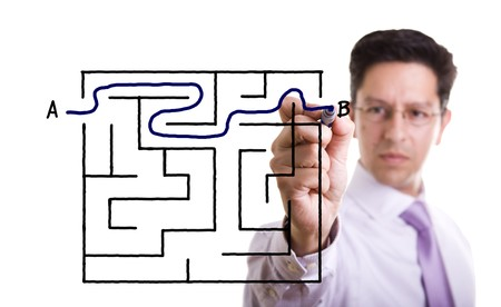 businessman finding the maze solution writing on the whiteboard Stock Photo - 7809882