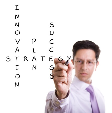 develop: Businessman solving a strategy plan to be successful in his business