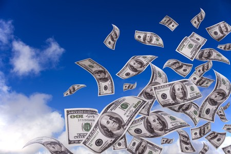 lots of dollar bills falling from the sky Stock Photo - 8027629