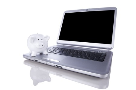 Piggy bank over a modern laptop, the cost of technology and information (isolated on white) Stock Photo - 8027462