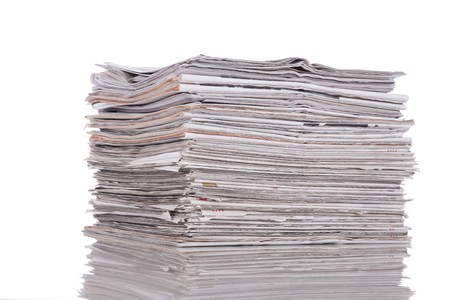 Stack of newspaper isolated on white photo