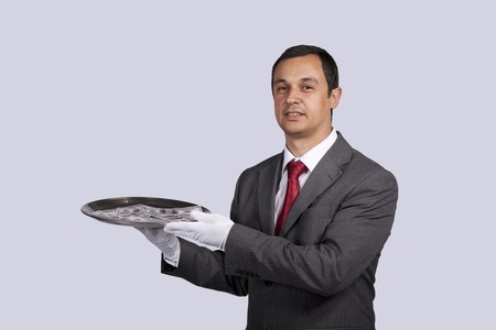 businessman serving you money on a plate Stock Photo - 8172104