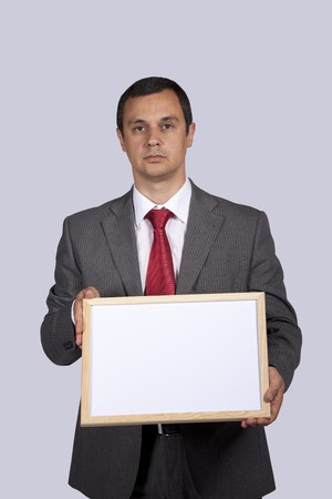 businessman holding a blank whiteboard Stock Photo - 8171789