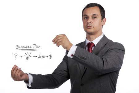 mature businessman holding a business plan solution Stock Photo - 8172263