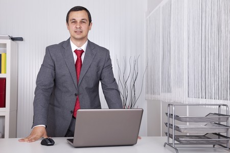 Modern and powerful businessman at his office Stock Photo - 8171929
