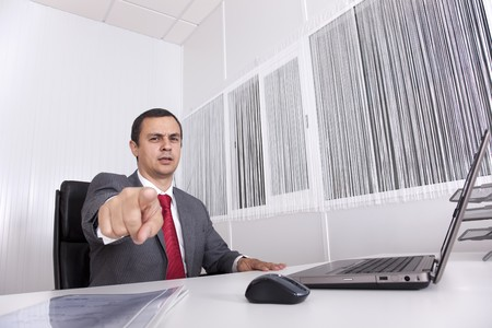 Bossy mature businessman at the office pointing to you Stock Photo - 8171942