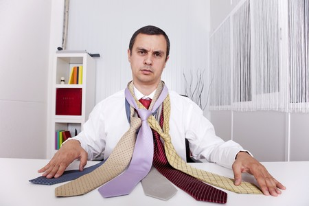 mature businessman looking to a lot of neckties, thinking what to choose Stock Photo - 8171918