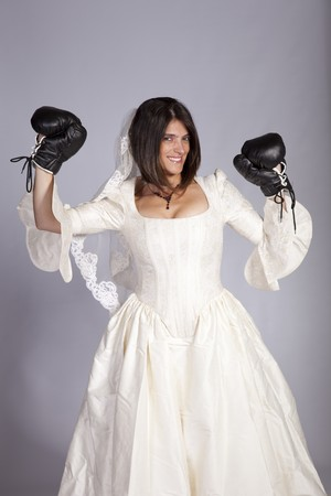 Crazy beautiful bride with boxing gloves (grey background) Stock Photo - 8172125