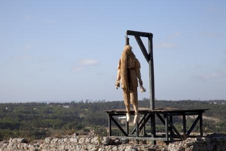 noose: Ancient castle with a dead hangmen