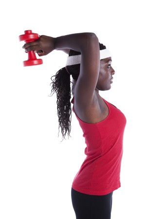 athletic wear: african young woman exercising her muscle with dumbbell (isolated on white) Stock Photo