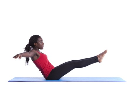 torna: young african woman exercising with perfect body balance (isolated on white) Stock fotó
