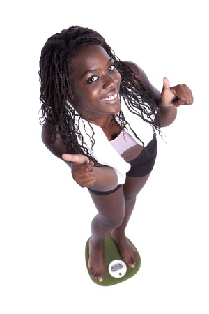 satisfied: african young woman happy with her diet results (isolated on white) Stock Photo