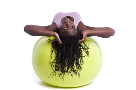 african woman exercising with a yellow pilate ball Stock Photo - 8172101