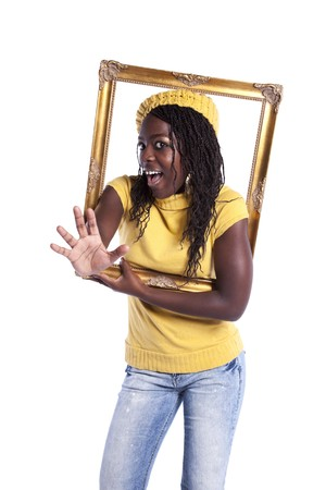 young beautiful african woman inside an antique picture frame (isolated on white) photo