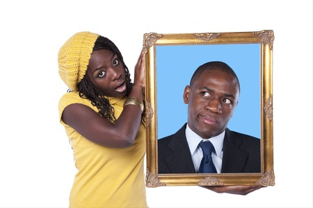 young african woman holding a portrait of a businessman with a funny expression (isolated on white) photo
