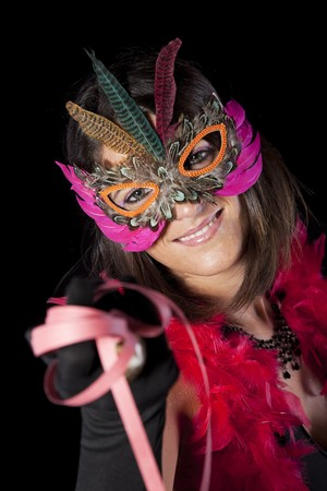 beautiful woman celebrating with a seductive mask (isolated on black) photo