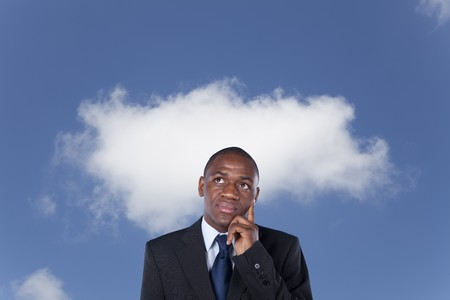African businessman thinking with cloud on the background (cloud computing concept) photo