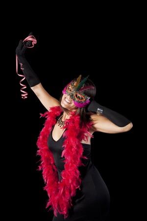 beautiful woman celebrating with a seductive mask (isolated on black) photo