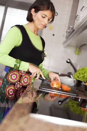 modern woman preparing some healthy food at her kitchen (selective focus with shallow DOF) Stock Photo - 8174864