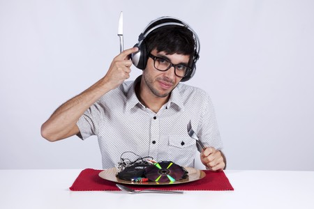 out of context: Crazy young man eating music at his dinner plate