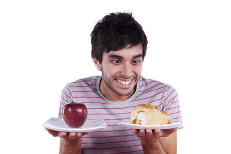 what to eat: man thinking what to eat between an apple and a cake (isolated on white)