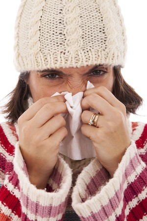 woman sneezing to a paper tissue in winter (isolated on white) photo