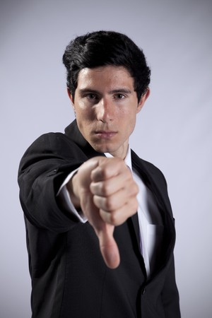 Businessman showing his rejection with his thumb down Stock Photo - 8174756