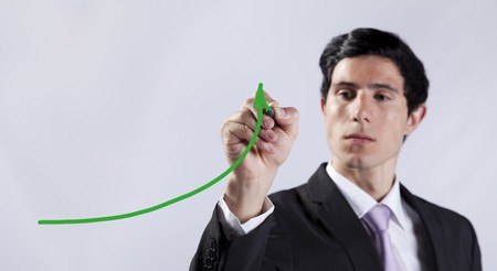 Modern businessman writing the business stats progress in the whiteboard (selective focus) Stock Photo - 8171845