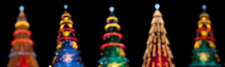 Five defocus christmas tree at night (isolated on black) Stock Photo - 8172011