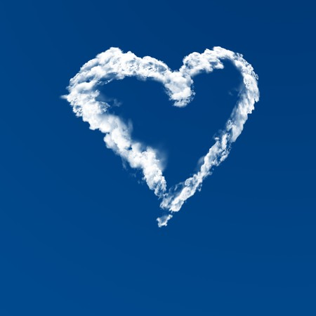 Cloud heart shape in a blue sky photo