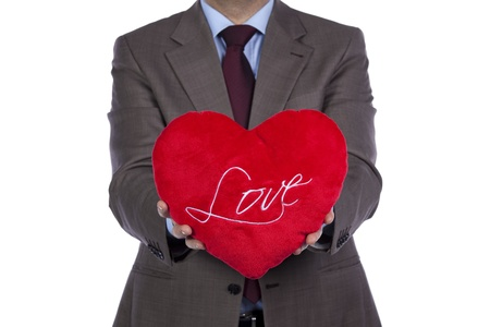 Businessman holding a red pillow with a heart shape Stock Photo - 8651939
