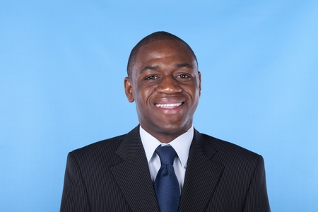African businessman smiling with a blue background Stock Photo - 8652613