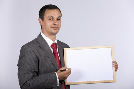 businessman holding a blank whiteboard Stock Photo - 8652587