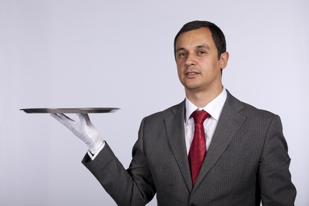 businessman showing you a solution (copyspace over the tray) Stock Photo - 8652411