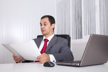 Mature businessman working at the office photo