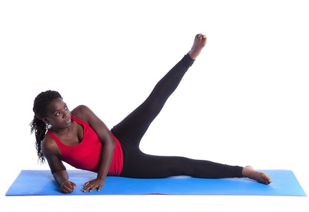 young african woman exercising with perfect body balance (isolated on white) photo