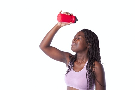 Young african woman refreshing  her seat after the exercise (isolated on white) photo