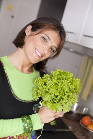 modern woman preparing some healthy food at her kitchen (selective focus with shallow DOF) photo
