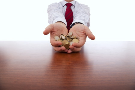 businessman showing a lot of coins in his hands photo