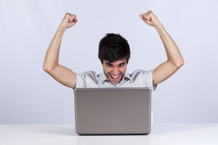 young modern businessman excited with his success with his laptop computer Stock Photo - 8652169
