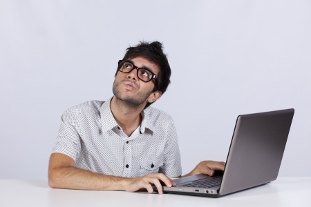 copyspace: Young man thinking about a solution for a computer problem Stock Photo