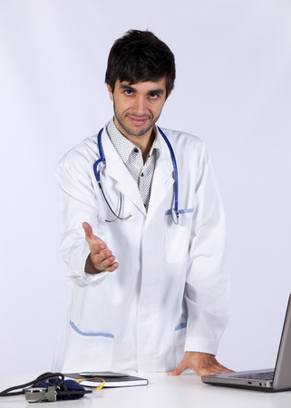 happy young doctor at his office (isolated on white) Stock Photo - 8652168