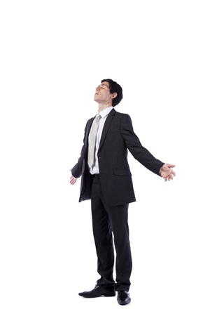 Businessman meditating with his eyes closed and arms open (isolated on white) photo