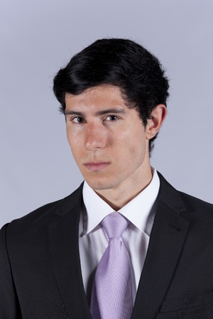 Portrait of a young businessman with a grey background Stock Photo - 8652748