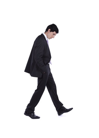 walking down: Businessman walking and looking down isolated on white (some motion blur)