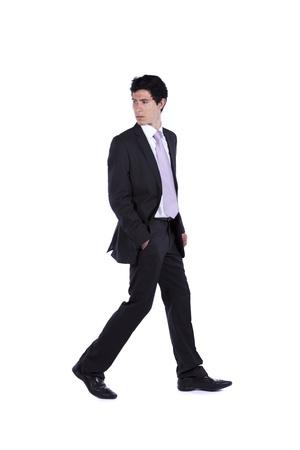 Zakenman lopen en terugkijken geïsoleerd op wit (sommige motion blur)