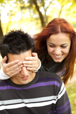 woman covering the eyes to his boyfriend (selective focus with shallow DOF) Stock Photo - 8651539