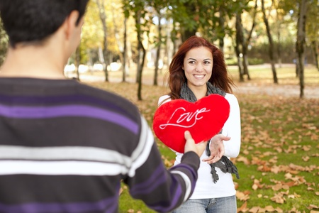 joy of giving: Love and affection between a young couple at valentine day (selective focus with shallow DOF) Stock Photo